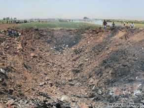 Crashed Iranian airliner 'disintegrated into pieces'  (15/07/09) Art_ir10
