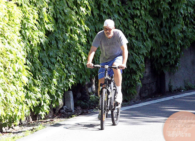 George Clooney's bicycle ride in Como - and his little ass! Donkey17