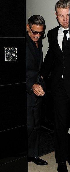 George Clooney exiting his hotel in London  Leavin10
