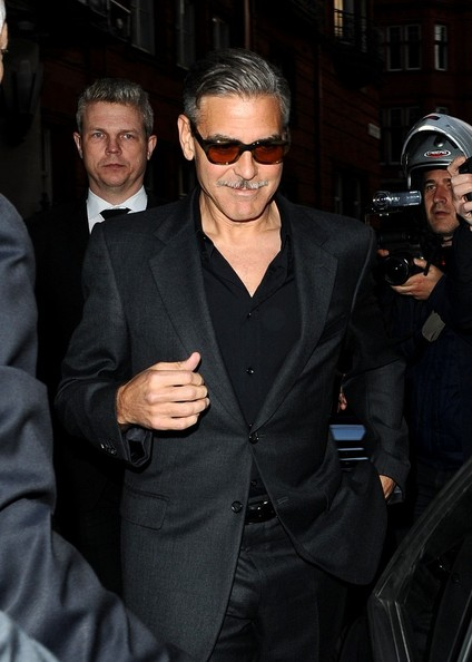 George Clooney exiting his hotel in London  Leavin13