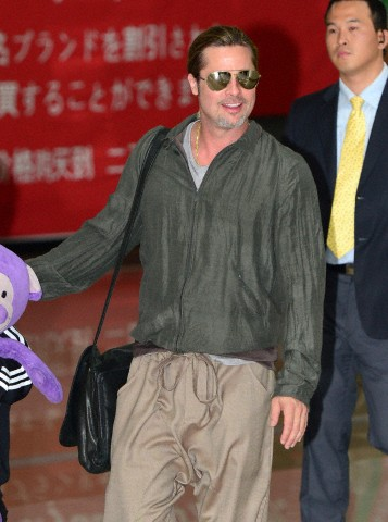 Brad and Pax arrive at Gimpo Airport..Seoul, South Korea, June 11th 2013 00002017