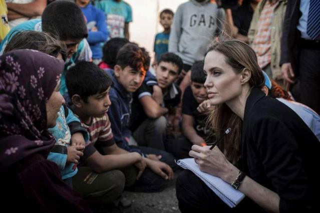 Angelina meeting with Refugees at the Jaber Border Crossing in Jordan..June 18th 2013 00133216