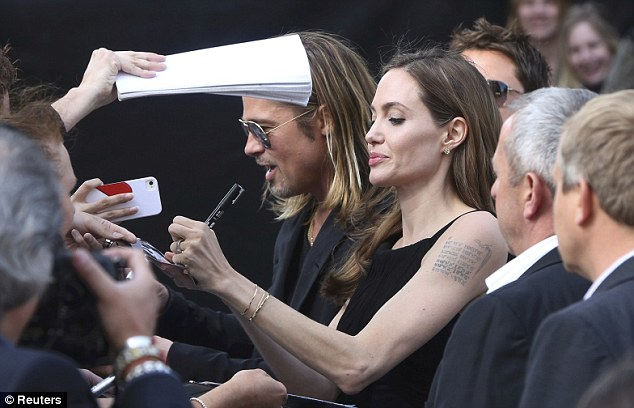 Brad and Angelina at World War Z Premiere..Leicester Square, London..June 2nd, 2013 - Page 2 2ba16438