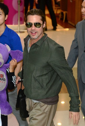 Brad and Pax arrive at Gimpo Airport..Seoul, South Korea, June 11th 2013 Kgrhqn25