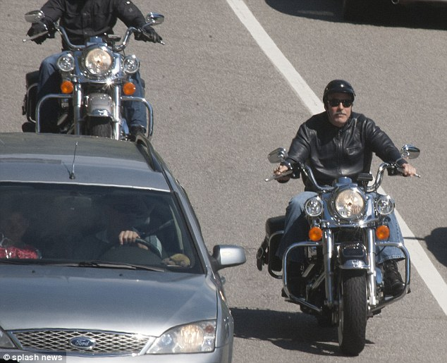 George Clooney goes for a motorbike ride in como Articl11