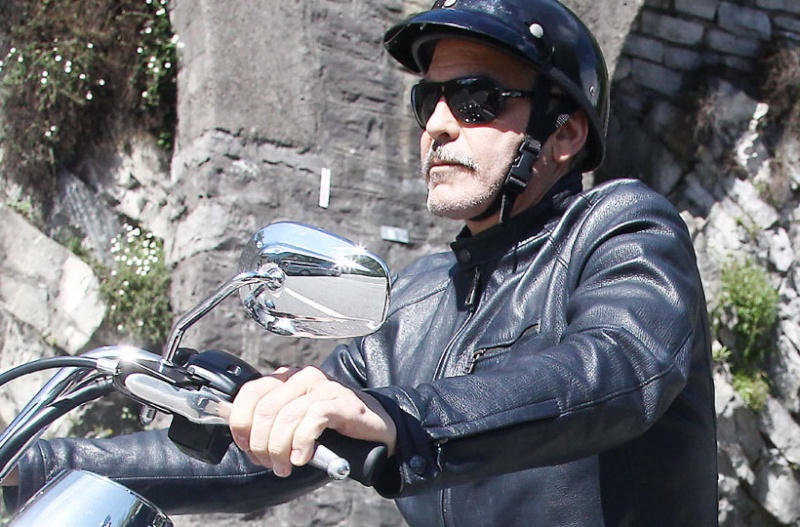 George Clooney goes for a motorbike ride in como Cloone19