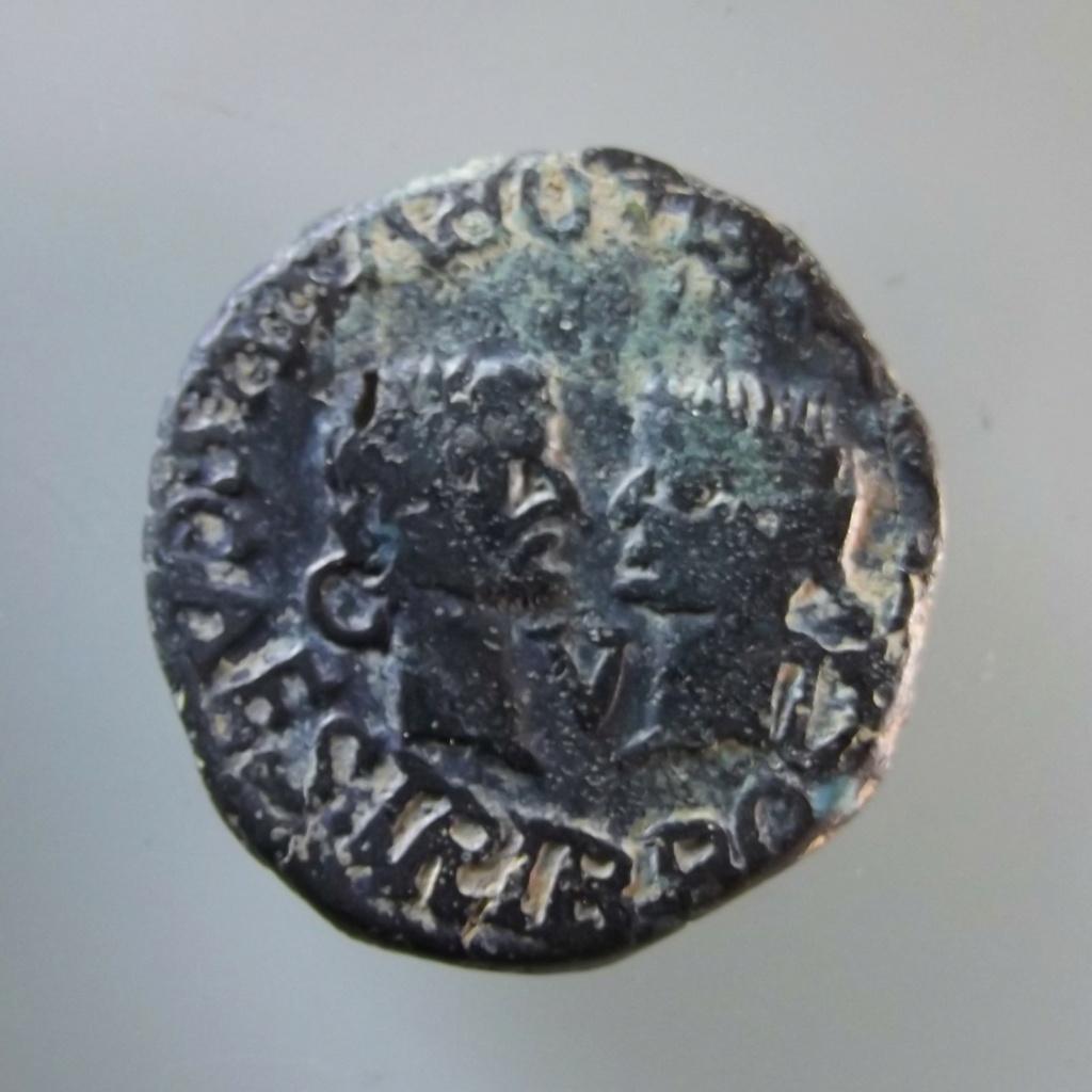 As de Tarraco, época de Tiberio. IVLIA AVGVSTA DRVSVS CAES TRIB POT IV / CVT. Cabezas afrontadas de Druso y Livia. A213