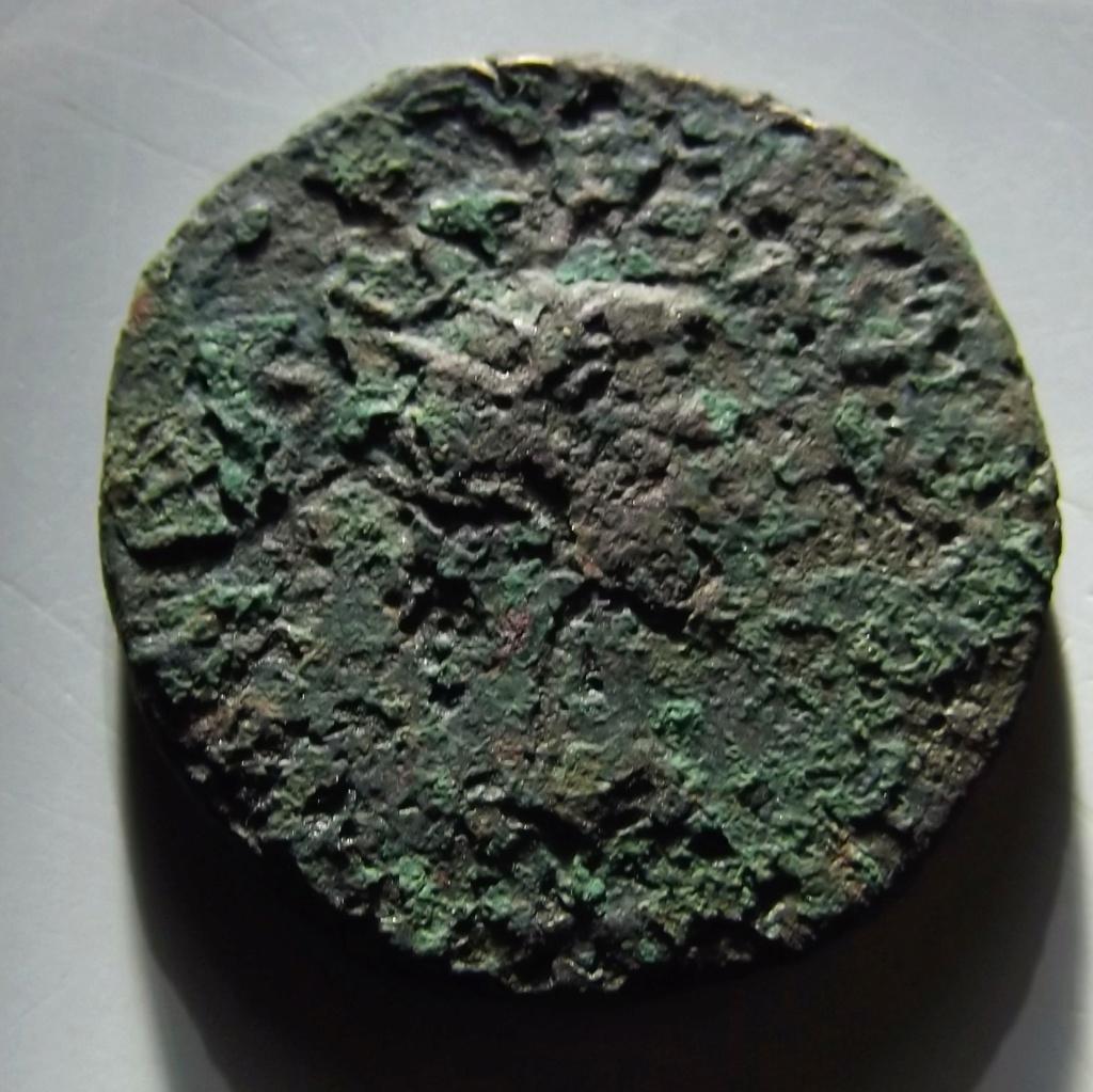 As de Tarraco, época de Tiberio. DIVVS AVGVSTVS PATER C V T T R. Busto radiado de Augusto a dcha. Dscf3314