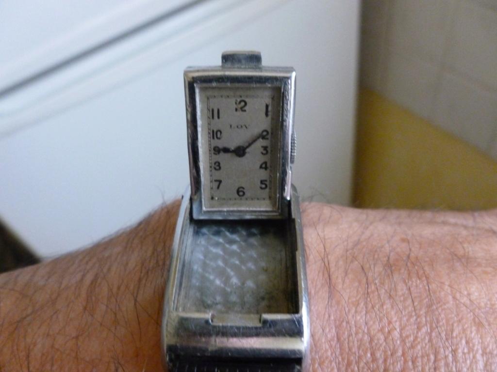 Lov montre, modèle rare, originale, insolite et brevetée. Bourse11