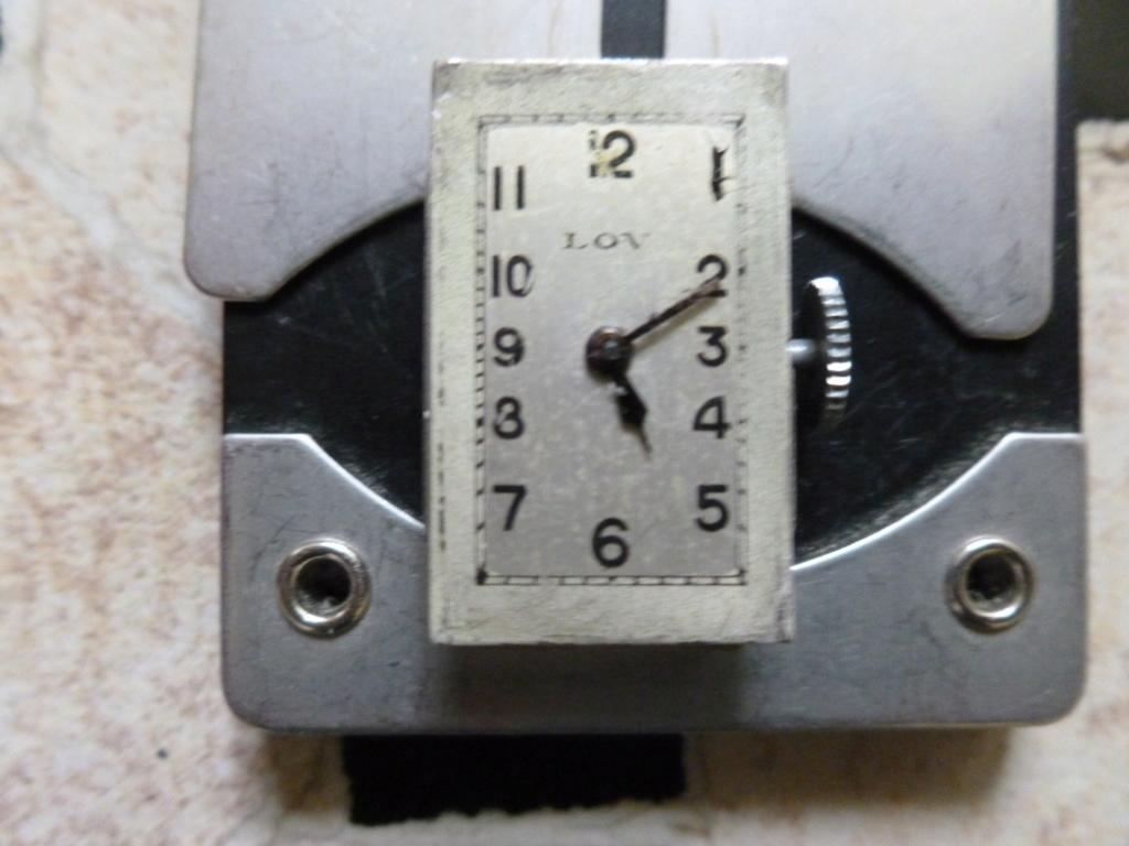 Lov montre, modèle rare, originale, insolite et brevetée. Bourse18