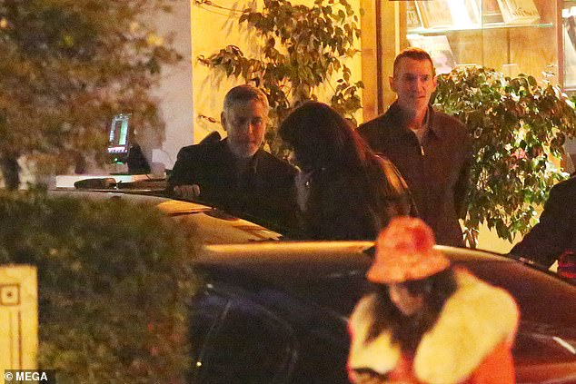 George Clooney looks dapper as he leaves romantic dinner with wife Amal and hops into a taxi in Hollywood   95649411