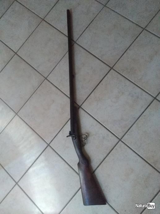 Identification d'un fusil et d'un sabre  E6eb4810