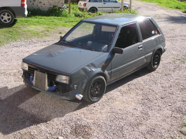 Golden Boy - Dödsgrå turbo Starlet (bilen såld) Ny_int12