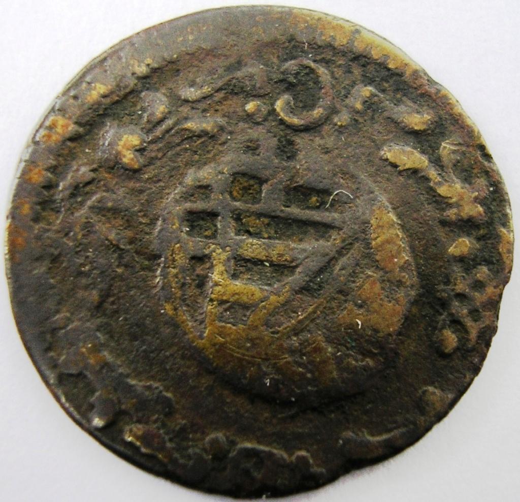 Moneda a identificar Carlos18