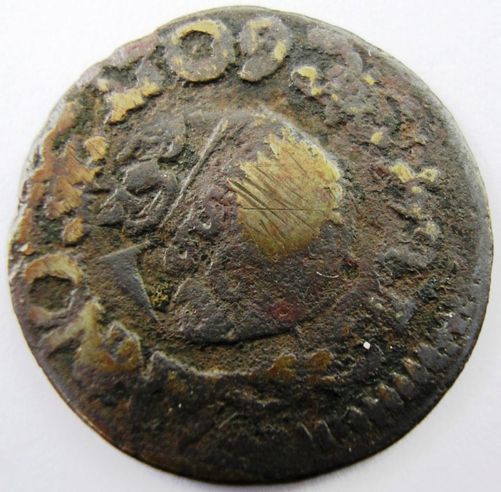 Moneda a identificar Carlos19
