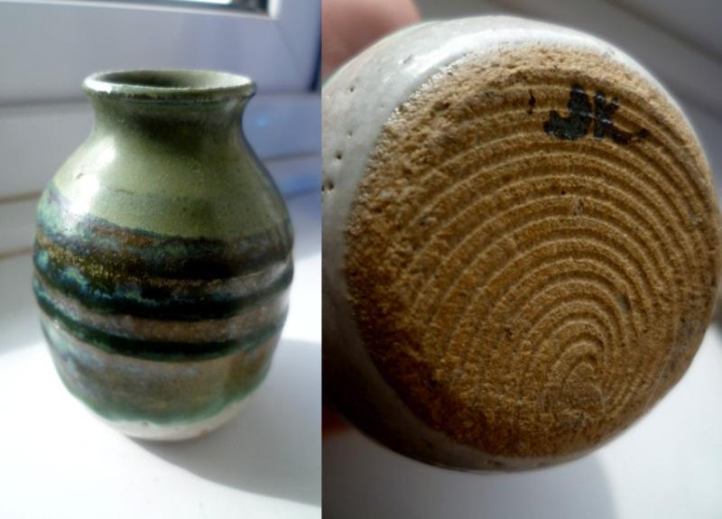 A small little pot vase with painted JK initials Jk10