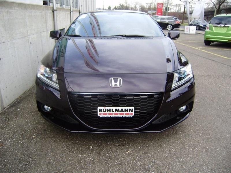 Démontage du support de plaque d'immatriculation avant Honda-11