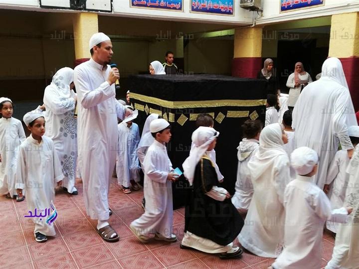 محاكاة للواقع - تلاميذ رياض أطفال يؤدون مشهد الحج والأضحية 6410