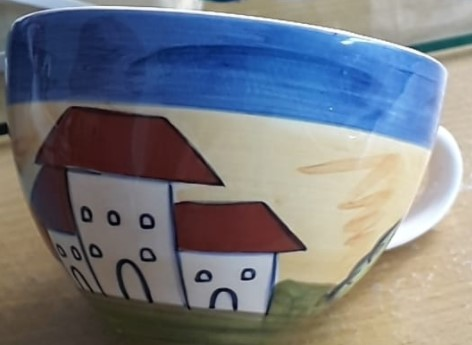 Who made this cup with 43 on its base? Cup_wi12