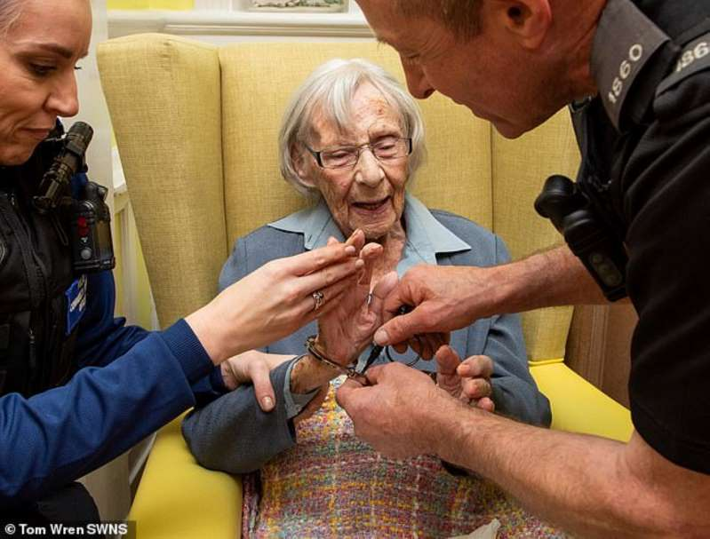 104 year old woman arrested and taken away in handcuffs. Bbv0go10