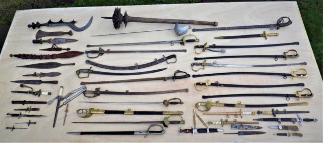 Qui s'y frotte s'y pique. Montrer nous votre collection d'armes blanches. Rimg2517
