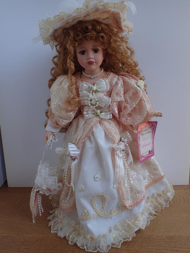 Donne 11 poupées de porcelaine P7209312