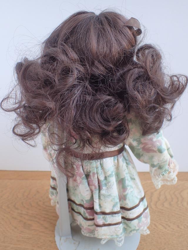 Donne 11 poupées de porcelaine P7209332