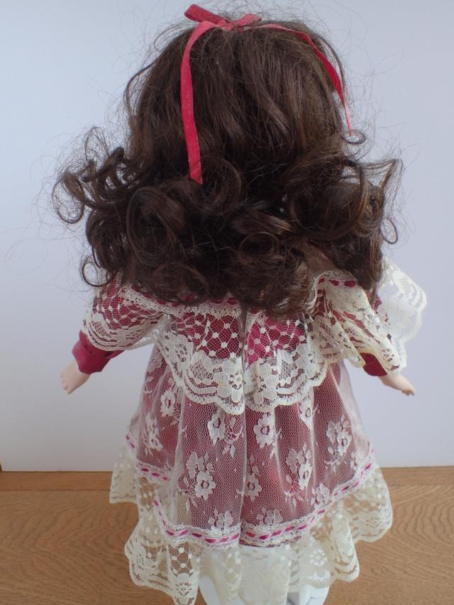 Donne 11 poupées de porcelaine P7209412