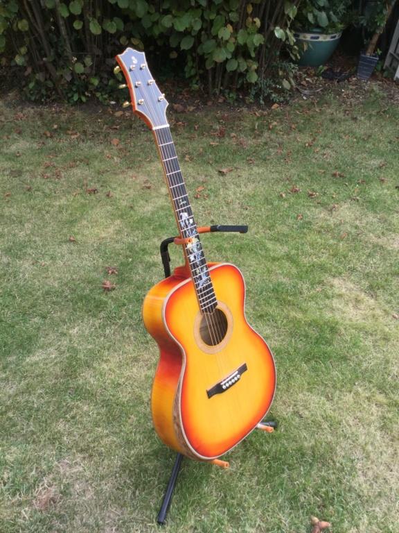 Nic77 et sa guitare A4194910