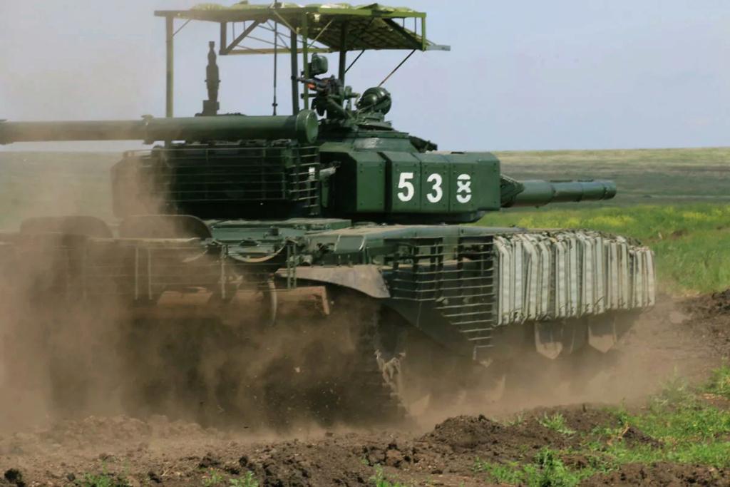 الجيش الروسي يبتكر طريقة لحماية دبابات T-72B3 من الهجمات العُلوية. 11133710