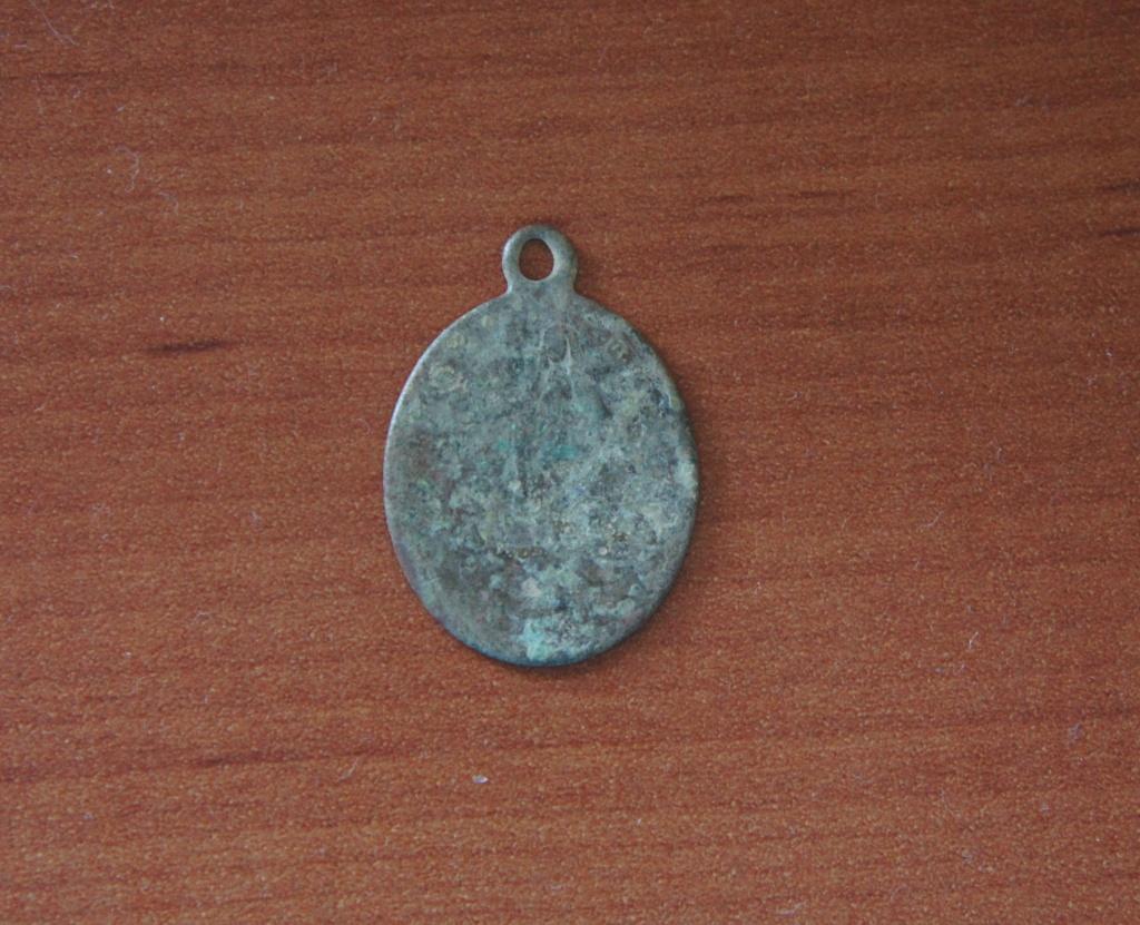 Identificación medalla 1210