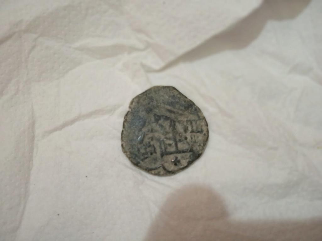 8 maravedís de Felipe III o IV resellados. Whatsa13