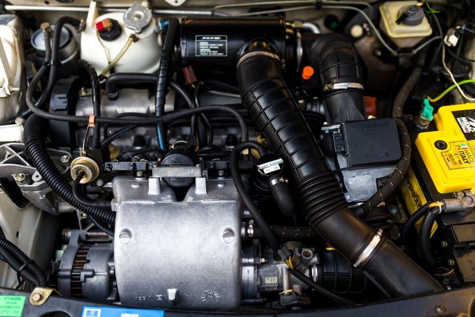 [62] 205 GTI 1L9 - 130cv -  AM90 - Gris Futura Img_4910