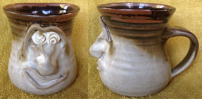 slab-formed face mug with big nose (moustache cup) and thrown mug with white eyes Whitee10