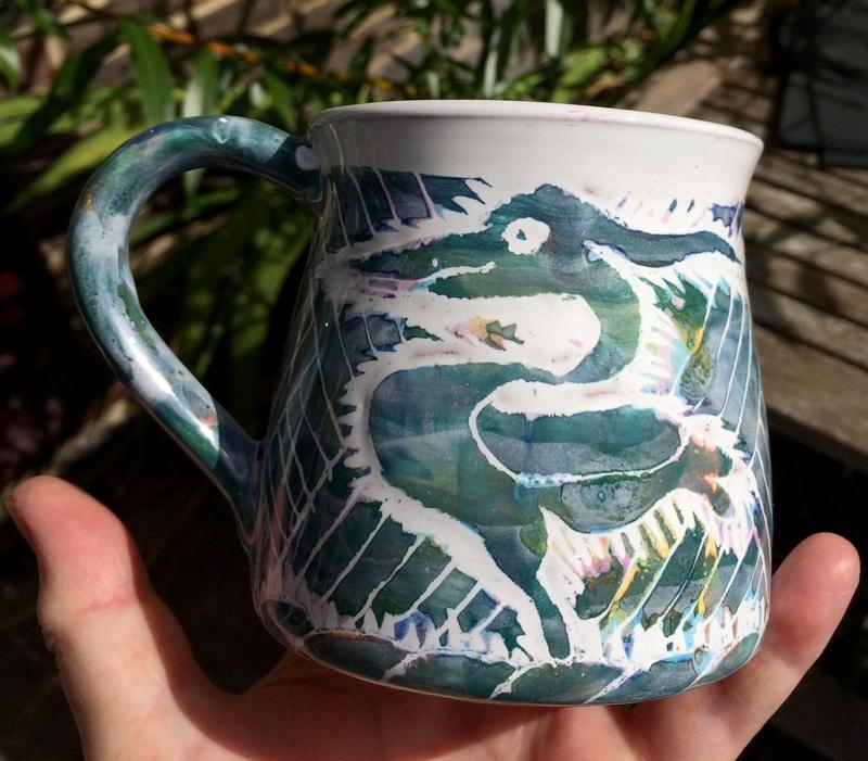 Mystery mug with sgraffito design. European Image99