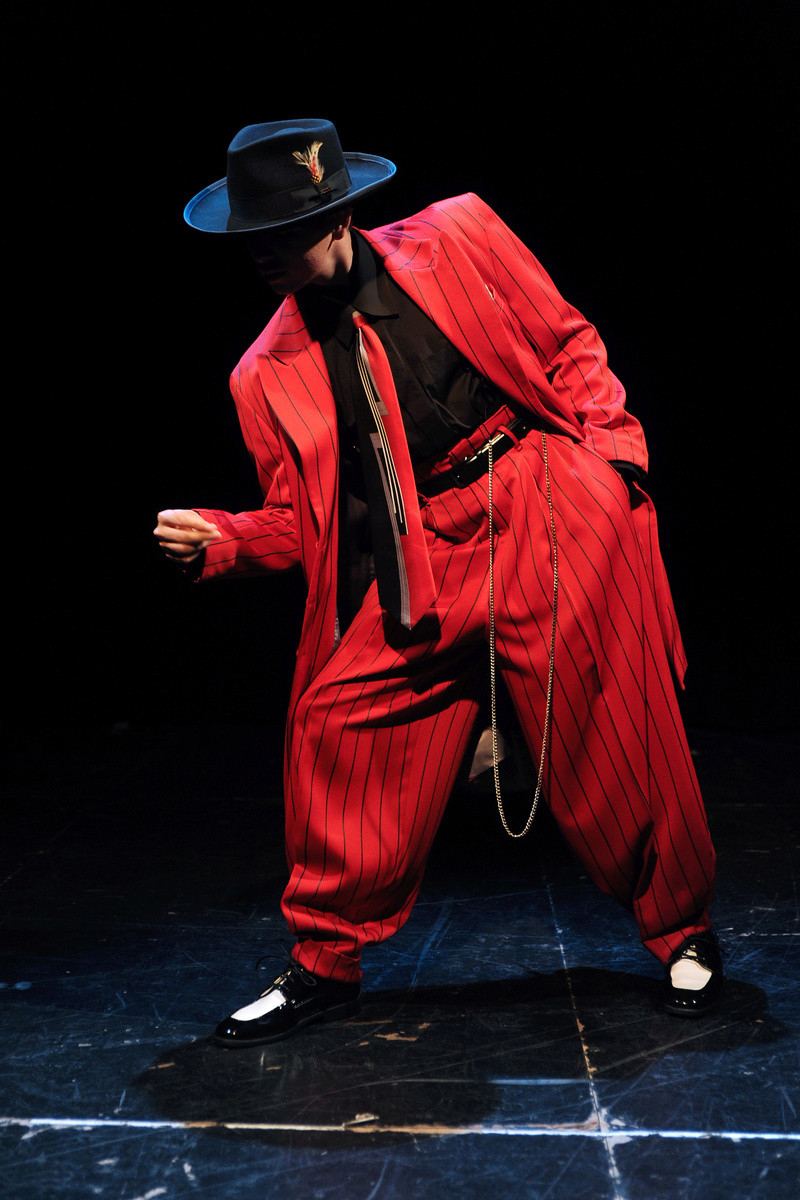African American Male Trend: The Zoot Suit known to many were first designed by African American tailors/entrepreneurs:  Known for its extravagant design, and was worn by African American  jazz singers and trumpeters entertainers: and swing dancers that w Zoot-p10