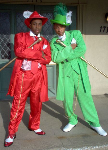 African American Male Trend: The Zoot Suit known to many were first designed by African American tailors/entrepreneurs:  Known for its extravagant design, and was worn by African American  jazz singers and trumpeters entertainers: and swing dancers that w Zoot_b10