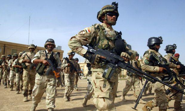 Why do the Iraqi's wear 2 goggles? Iraqi210
