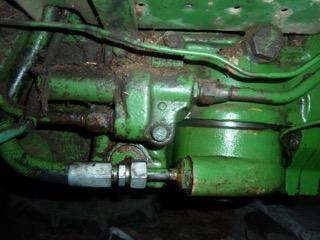 Problème huile hydraulique john deere 1120 Soupap10