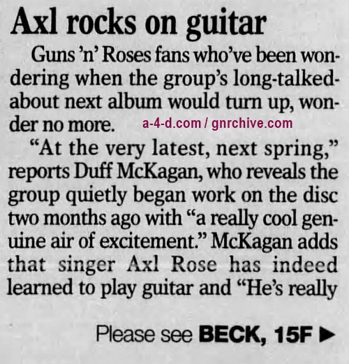 1996.07.28 - St. Cloud Times - Axl rocks on guitar (Duff) 1996_023