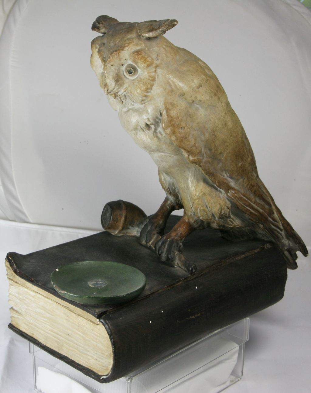 Book, smoking pipe and owl??  K110