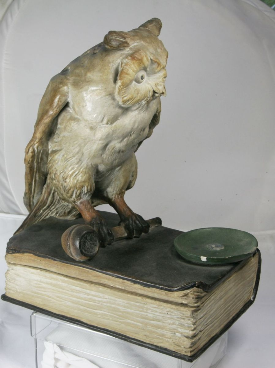 Book, smoking pipe and owl??  K210