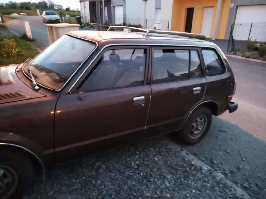 Enfin j'en ai une .. Honda CIVIC SB1 de 1977 1ère génération - Page 2 Receiv10