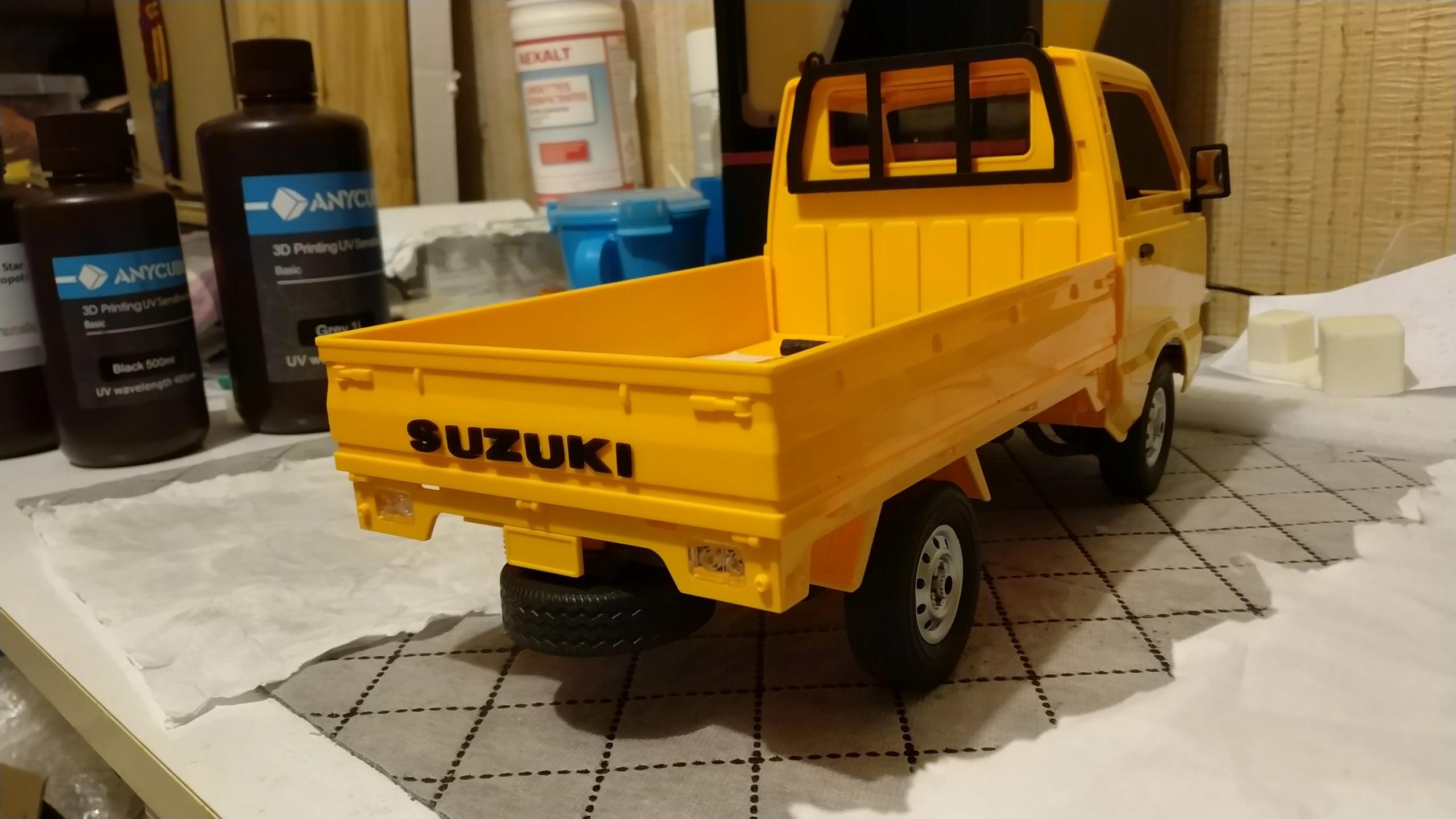 Un énorme camion de plus, le WPL D12 Suzuki Carry 1/10... - Page 2 Img_2739