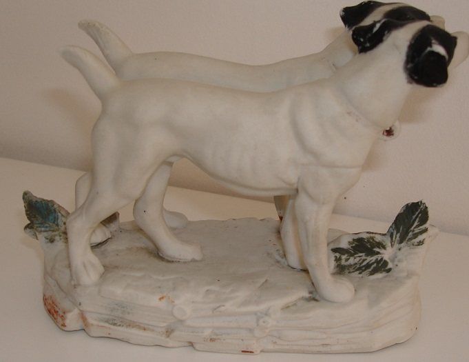 Two porcelain bisque Jack Russell's on a stand Dsc08222
