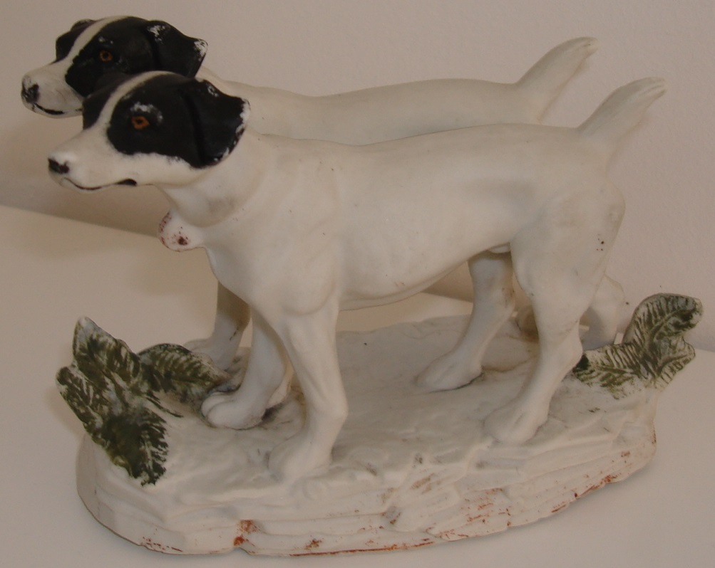 Two porcelain bisque Jack Russell's on a stand Dsc08223